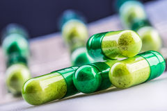 Pills. Tablets. Capsule. Heap of pills. Medical background. Close-up of pile of yellow green  tablets Royalty Free Stock Photography