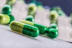 Pills. Tablets. Capsule. Heap of pills. Medical background. Close-up of pile of yellow green  tablets Royalty Free Stock Images