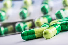 Pills. Tablets. Capsule. Heap of pills. Medical background. Close-up of pile of yellow green  tablets Stock Photography