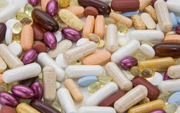 Pills tablets capsules dosage medicine background Stock Photos