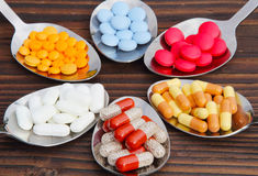 Pills, tablets, capsules. On the spoons Royalty Free Stock Images