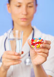 Pills, tablets and drugs heap in doctor hand Royalty Free Stock Photos
