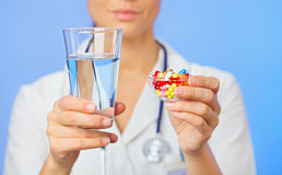 Pills, tablets and drugs heap in doctor hand Stock Image