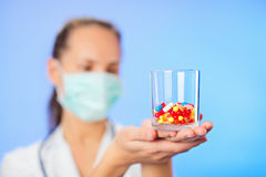Pills, tablets and drugs heap in doctor's hand Stock Images