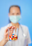 Pills, tablets and drugs heap in doctor's hand Royalty Free Stock Photo