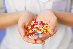 Pills, tablets and drugs heap in doctor's hand Royalty Free Stock Photography
