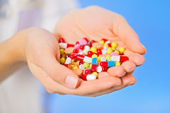 Pills, tablets and drugs heap in doctor's hand Stock Image