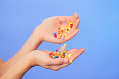 Pills, tablets and drugs pouring in hands Royalty Free Stock Photo