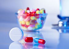 Pills and tablets macro still life on white blue Royalty Free Stock Photo