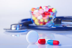 Pills and tablets macro still life on white blue Stock Image