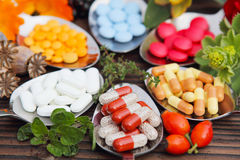 Pills, tablets and medicinal herbs. Pills, tablets, capsules and medicinal herbs Stock Image