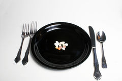 Pills or tablets on plate Stock Photo