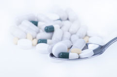Pills and tablets on spoon Stock Photo
