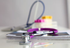 Pills ,tablets and stethoscope on white background Royalty Free Stock Images