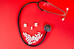 Pills ,tablets and stethoscope on white background Royalty Free Stock Photography