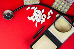Pills ,tablets and stethoscope on white background Royalty Free Stock Photo