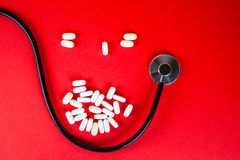 Pills ,tablets and stethoscope on white background Stock Image