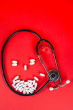 Pills ,tablets and stethoscope on white background Stock Images