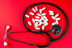Pills ,tablets and stethoscope on white background Royalty Free Stock Image