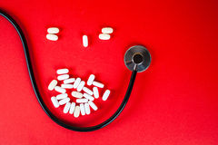 Pills ,tablets and stethoscope on white background Stock Photography