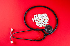 Pills ,tablets and stethoscope on white background Royalty Free Stock Photos