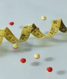 Pills and Tape Measure Stock Image