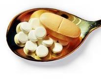 Pills on a teaspoon Royalty Free Stock Photography