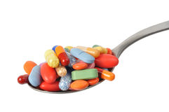Pills on a Teaspoon Royalty Free Stock Images