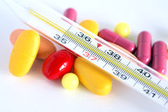 Pills And Thermometer Stock Photos