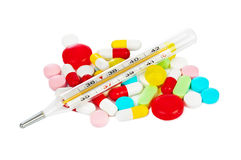 Pills and thermometer Royalty Free Stock Image