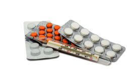 Pills and thermometer Royalty Free Stock Photos