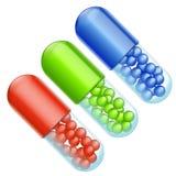 Pills three color Royalty Free Stock Image