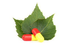 Pills with three leaves. Pills close-up with three leaves Stock Photography