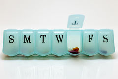 Pills for Thursday. Pill box with Thursday& x27;s pills visible Royalty Free Stock Images