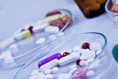 Pills to patients Stock Photo