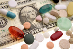 Pills on U.S. note Royalty Free Stock Photo