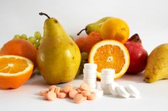 Pills and variout fruit Royalty Free Stock Photo