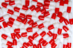 Capsules. Vertical layout on white background. Red and white capsules Royalty Free Stock Photography