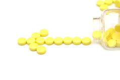Pills in vial isolated on white Royalty Free Stock Photo