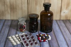 Tablets and pills different colors. The pills in the vial royalty free stock photography