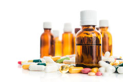 Pills and vitamin with bottle isolated Stock Images