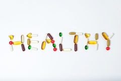 Pills of vitamin and medicine on white background Royalty Free Stock Photos