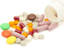 Pills and vitamins. Tablets, pills and vitamins on a white background Royalty Free Stock Photography
