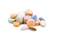 Pills and vitamins. Isolated over white background Stock Photos