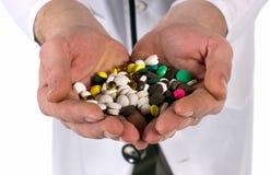 Pills and vitamins. Closeup of medicine pills and vitamins  into hands Stock Images