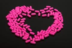 Pills, vitamins on black background Stock Photo