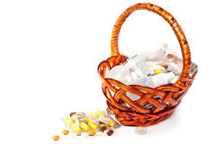 Pills and vitamins in brown basket Royalty Free Stock Photography