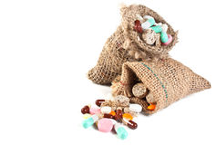 Pills and vitamins in a linen sac Royalty Free Stock Images