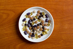 Pills, vitamins on plate Royalty Free Stock Photography