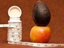 Pills Vs. Healthy Diet Stock Images